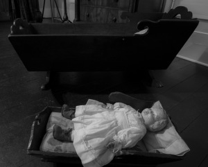 Antique doll and crib at Pond Spring. (photo by Marjorie Kaufman)